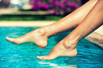 Woman at the pool in summer